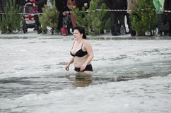 People bathe in the river in winter Stock Images