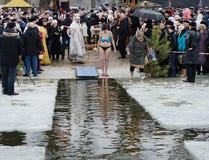 People bathe in the river in winter . Christian religious festival Epiphany. Novomoskovsk, Dnepropetrovsk region. Ukraine -19 January : religious holiday of Royalty Free Stock Photos