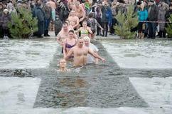 People bathe in the river in winter . Christian religious festival Epiphany. Novomoskovsk, Dnepropetrovsk region. Ukraine -19 January : religious holiday of Royalty Free Stock Photography