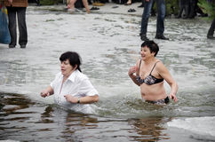 People bathe in the river in winter . Christian religious festival Epiphany.  Royalty Free Stock Photos