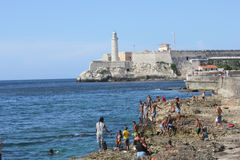 People bathing and the Castle of the Royal Force, Havana Royalty Free Stock Image
