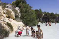 People bathing in the free area of Bagno Vignoni in Tuscany Royalty Free Stock Photo