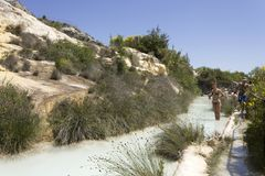 People bathing in the free area of Bagno Vignoni in Tuscany Royalty Free Stock Photos