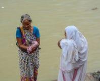 People bathing on Ganges River. Varanasi, India - Jul 12, 2015. Women bathing on Sacred Ganges River in Varanasi, India. Varanasi is the holiest of the seven Stock Photos