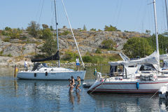 People bathing in Guest harbour Stockholm archipelago Royalty Free Stock Images