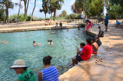 People bathing in the historic Ein Moda Spring pool Stock Photo