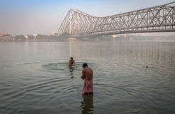 People bathing in river hooghly near Howrah bridge, Kolkata. Royalty Free Stock Photo