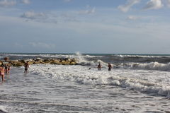 People bathing in rough seas Royalty Free Stock Images