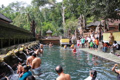 People bathing at Sacred Fountains of Tirta Empul Stock Photo