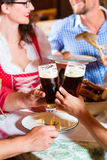People in Bavarian Tracht eating in restaurant or pub Royalty Free Stock Photography