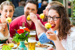 People in bavarian Tracht eating in restaurant or pub Stock Photo