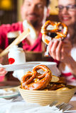 People in Bavarian Tracht eating in restaurant or pub Stock Images