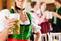 People in Bavarian Tracht in restaurant Royalty Free Stock Photo