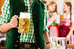 People in Bavarian Tracht in restaurant Stock Photo