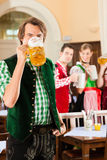 People in Bavarian Tracht in restaurant Royalty Free Stock Images