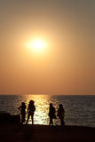 People on the beach. Sunset with people on a beach in Corfu, Greece Royalty Free Stock Images