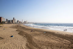 People on Beach Against City Skyline in Durban Stock Image