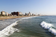 People on Beach Against Durban City Skyline Royalty Free Stock Photo