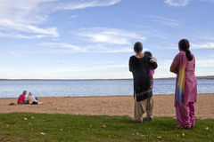 People on the beach, Alberta, Canada. People on the beach by the lake in Alberta, Canada Royalty Free Stock Images