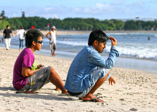 PEOPLE ON THE BEACH IN BALI Stock Image
