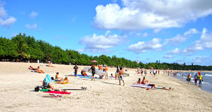 PEOPLE ON THE BEACH IN BALI Royalty Free Stock Images