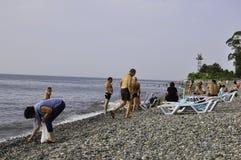 PEOPLE ON THE BEACH OF BLACK SEA IN BATUMI Stock Image
