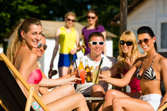 People at beach drinking having a party Royalty Free Stock Images