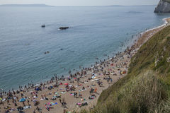 People on the beach - Durdle Door, Dorset, England. Royalty Free Stock Image