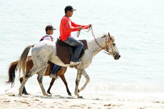 People , beach and horse. Pengkalan Balak Beach, Melaka, Malaysia - March 25, 2017 ; Malaysian People doing their activity ride a horses during hot weather at Stock Photo