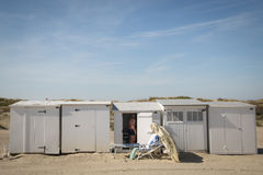 People on the beach in Knokke, Belgium. KNOKKE, BELGIUM - MAY 2016: People on the beach surrounded by the typical cabins in Knokke, Belgium Royalty Free Stock Images