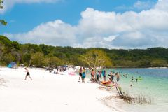 People at the beach at Lake McKenzie, one of the popular freshwater lake at Fraser Island, Australia stock photo