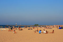 People at Beach on Lake Michigan in Chicago. CHICAGO - JUL 29: Unidentified people at Beach on Lake Michigan during summer in Chicago, Illinois, USA on July 29 Royalty Free Stock Photos