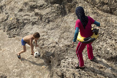 People at the beach, Lebanon. A women and an child on the rocky beach, Lebanon Stock Photography