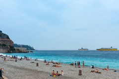 People on the beach of the mediterranean sea in Nice Royalty Free Stock Photos