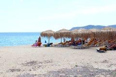 People beach parasols, Sarti, Chalkidiki, Greece Royalty Free Stock Photos