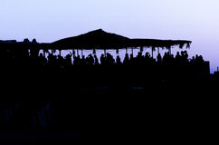 People on a beach party event in sunset. Dancing and partying. Summer electronic music. Silhouette of people Stock Images