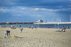 People on the beach. Pier & marina Stock Image
