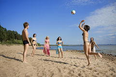 People on the beach playing volleyball stock image