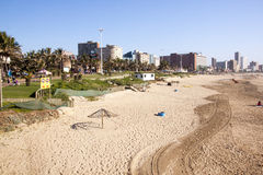 People on Beach and Promenade Against Durban skyline Stock Photography