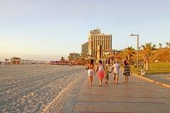 People on the beach promenade and modern hotels in Herzliya, Is Stock Photo