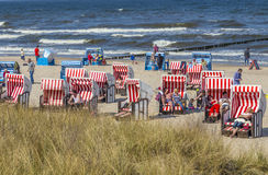 People at the beach in the roofed wicker beach chair Stock Photo