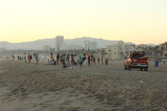 People at Beach. Beach scene, California. Lifeguard truck and people royalty free stock image