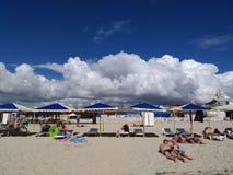 People on the beach by the sea, velvet season Stock Photo
