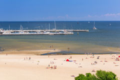 People on the beach of Sopot at Baltic Sea. SOPOT, POLAND - 7 JUNE: People on the beach of Sopot at Baltic Sea on 7 June 2014. Sopot is major health and tourist stock photos