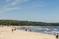 People at a beach in Sopot. View of the Baltic Sea and people at a beach in Sopot, Poland, on a sunny day in the autumn Royalty Free Stock Photography