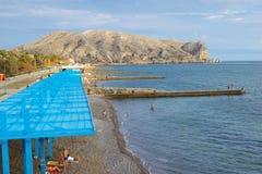 People on the beach of Sudak, Crimea Royalty Free Stock Photo