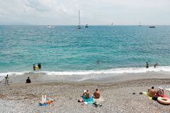 People on the beach in summer in Italy. royalty free stock image
