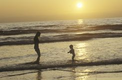 people on beach at sunset, North San Diego, CA Stock Photo