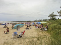 People at the Beach in Uruguay. Canelones, Uruguay, January -2015 - People enjoying a summer but cloudy day at the beach in Atlantida, one of the most famous Royalty Free Stock Photo