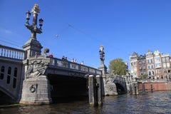 People on beautiful The Blue Bridge (Blauwbrug) , Amsterdam Royalty Free Stock Photo